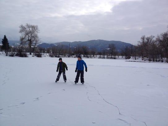 Kids play on the ice on the Livingston Lagoon.