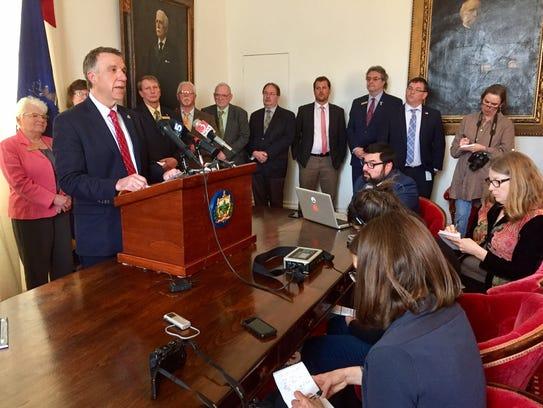 Gov. Phil Scott announces new settlement in alleged