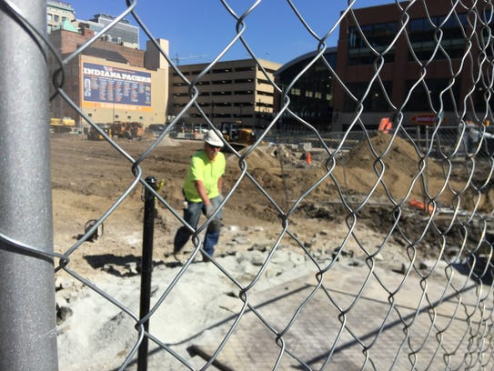 A construction worker walks through the future location