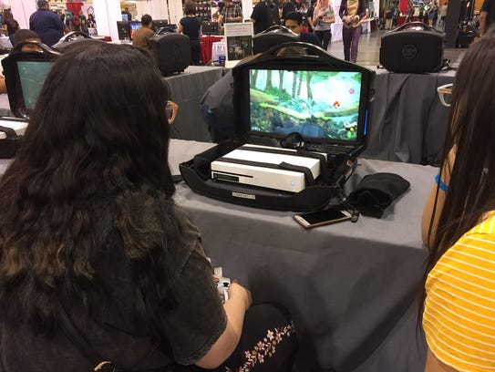 Diana Rodriguez plays the game Cuphead during Phoenix