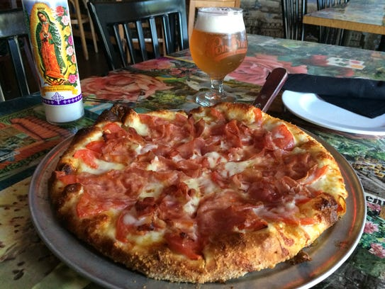 The Hot Honey Pizza and a Point Ybel sour from Nice
