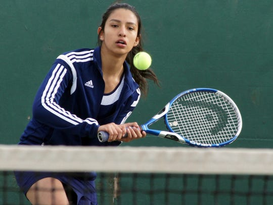 Freshman Lady Cat Betsy Macial uses her backhand to
