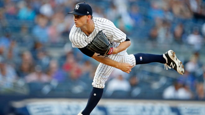 Jul 26, 2018; Bronx, NY, USA; New York Yankees starting pitcher Sonny Gray (55) pitches against the Kansas City Royals during the first inning at Yankee Stadium.