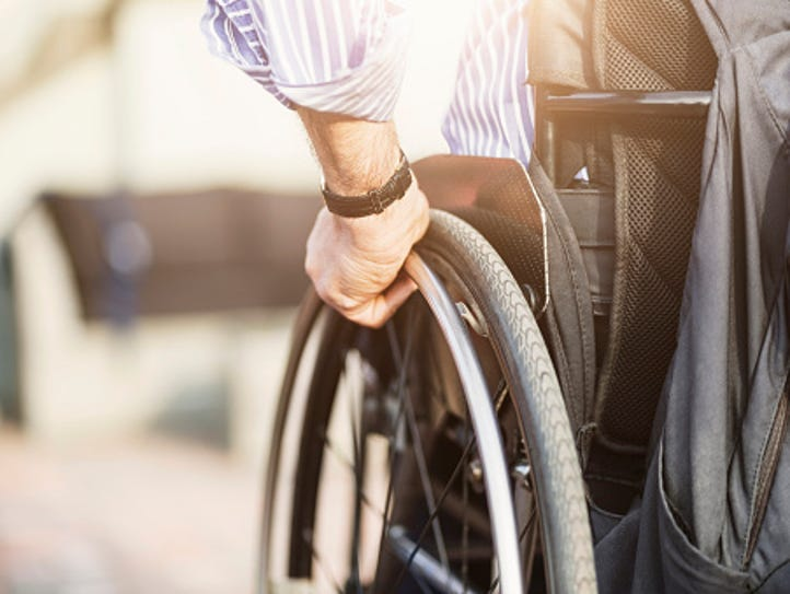 Cropped image of man in wheelchair outdoors