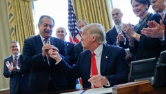 President Trump gives the pen he used to sign an executive