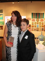Outstanding Member award winner Connie G. Rivera and her son at the 2016 American Institute of Architects Corpus Christi 2016 Honor Awards.