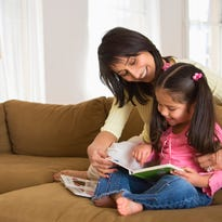 """""""Reading aloud is the single most important activity you can do with your child to help them develop language and literacy skills,"""" says Emily Bartels, program specialist for Reach Out and Read in the Carolinas."""