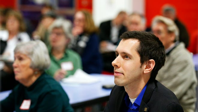 Springfield city councilman Justin Burnett listens to a presentation during a Zone 2 community meeting held in February at Pittman Elementary.