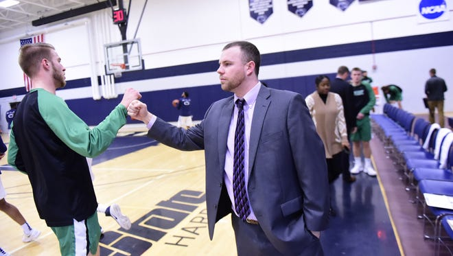 York Catholic graduate Jon Showers, right, takes over as an assistant coach at DeSales University after five years in the same role with the York College men's basketball team.