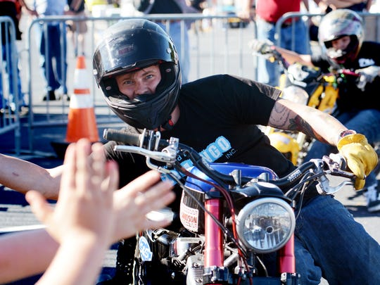 Cole Freeman high fives the crowd from his moving bike during warm-ups for the Ill Conduct Stunt Show at the Harley-Davidson York Vehicle Operations Open House Thursday, Sept. 28, 2017. The St. Louis-based attraction is performing three shows a day during the event which runs from 9 a.m. to 4 p.m. through Saturday. Bill Kalina photo