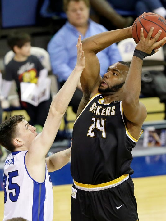 Wichita State forward Shaquille Morris shoots over Drake forward Nick McGlynn, left, during the first half of an NCAA college basketball game, Tuesday, Feb. 9, 2016, in Des Moines, Iowa. (AP Photo/Charlie Neibergall)