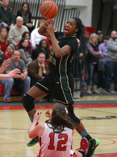 RH's Dana Watts (23) drives to the basket over Penfield's Margot Hetzke (12).