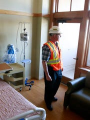 Larry Smith, director of facilities at San Juan Regional Medical Center, on Feb. 10 shows one of the patient rooms built in 2006 at the hospital in Farmington.