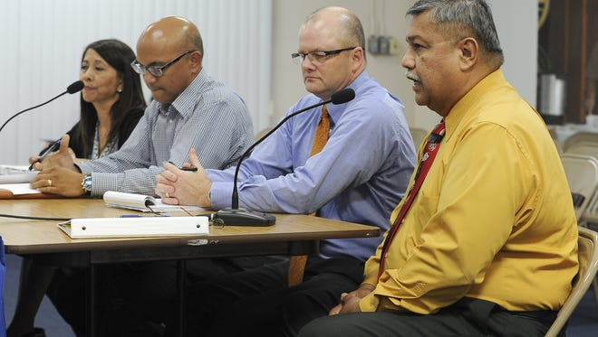In this August 2012 file photo,George Santos, right, director of Guam Department of Labor, speaks during a public hearing on Bill 453 at the Guam Legislature. The bill, which would have created a new government retirement plan, never was passed. A public hearing is scheduled for 6 p.m. Thursday at the Guam Legislature for the latest proposal for a hybrid retirement plan.