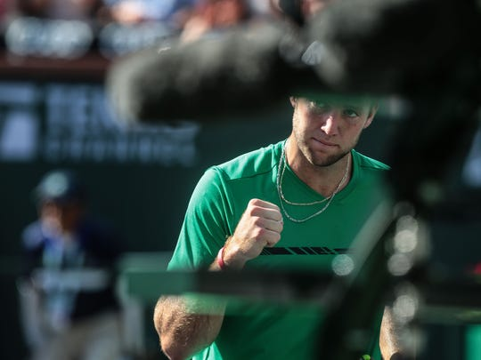 American Jack Sock after breaking Kei Nishikori, of