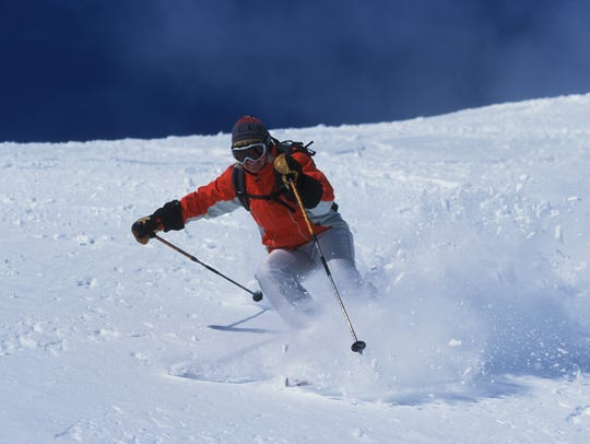 A skier enjoys powder at Bridger Bowl ski area.