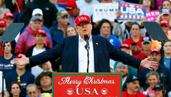 In this Dec. 17, 2016, photo, President-elect Donald Trump speaks during a rally at the Ladd–Peebles Stadium in Mobile, Ala. Trump will be the first U.S. president to have ever owned a casino, and the gambling industry is wondering how he will handle three major issues: internet gambling, sports betting and daily fantasy sports. The industry has sent its wish list to the president-elect. (AP Photo/Brynn Anderson)