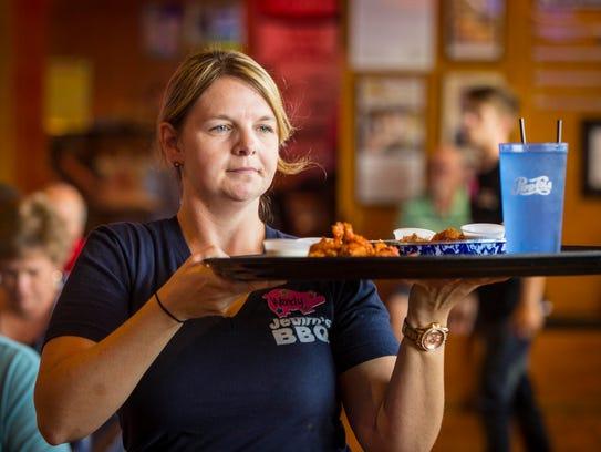 Server Wendy Becvar works the lunch crowd Jethro's