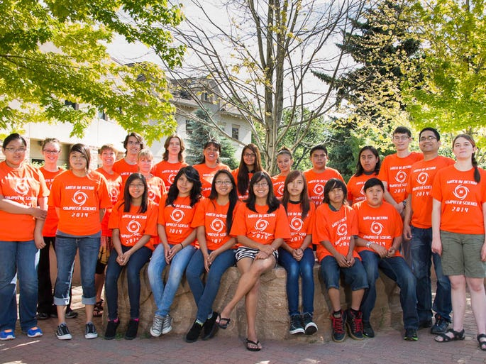 Participants in the 2014 Colorado State University Math in Action in Computer Science camp pose for a group photo, June 3, 2014. CSU's MACS camp provides Native American students from Cortez Middle School in Cortez, Colorado hands-on training with math concepts and their applications in computer science. Front Row: Latrell Jacket, Katelyn Paul, MayAnn Etsitty, Kanani Lansing, Ramona Etsitty, Ayanna Silas, Cyrell Dance, Ekco Blueeyes, Kyle Begay, Dr. Shrideep Pallickara, Kira Lindburg, Back Row: Gareth Halladay, Lisa Knebl, Ian Bertolacci, Pam Cox, Manny Watts, Justine Bayles, Allie Martinez, Nanabah Sam, Brendan Jones, Adrain Begay, Ryan Stern.
