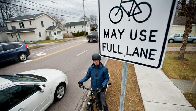 Liam Griffin has a lot of experiencing biking down North Ave. in Burlington's New North End. Unfortunately, that experience includes being shouted at by passing cars despite signs designating that cyclists can share the road. It's just one example of how polarized the debate over a dedicated bike lane has become.