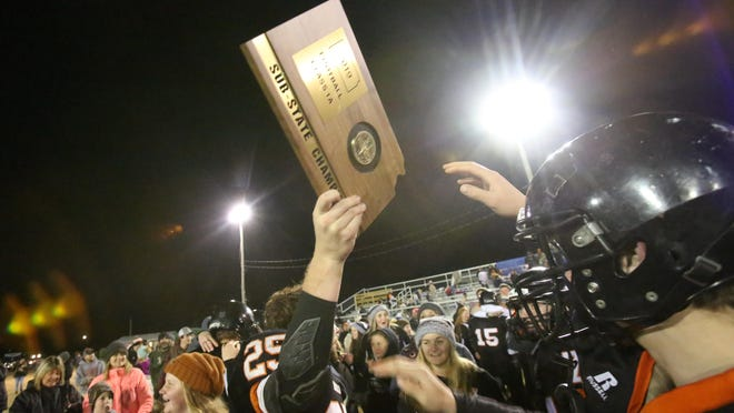 Centralia, shown after its state semifinal win over Jackson Heights, went on to capture the Class 1A state championship last season, going 12-1. The title was the program's fourth in the last 10 years.