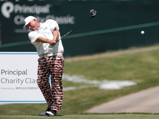 Mark Calcavecchia hits off the 18th tee during the