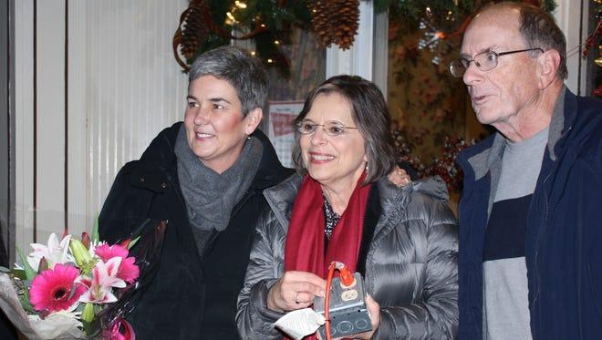 From left: Village of Endicott Trustee Eileen Konecny, Assemblywoman Donna Lupardo and Village of Endicott Trustee Dave Baker turn on 14 snowflake lights Tuesday evening on Washington Avenue in Endicott.