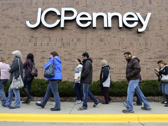 A line forms outside of JC Penny as Christmas shopping