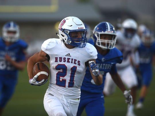 Reno's Evan Moore (21) runs for a first half touchdown