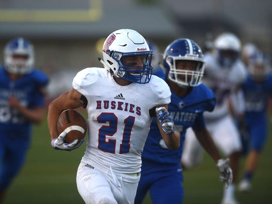 Reno's Evan Moore (21) runs for a first half touchdown while taking on Carson during their football game in Carson City on Sept. 1