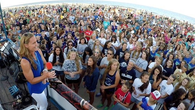 United States Women's National team captain Christie Rampone speaks to fans on the Manasquan beach at Main Street Thursday evening, August 13, 2015, after a parade in her honor.