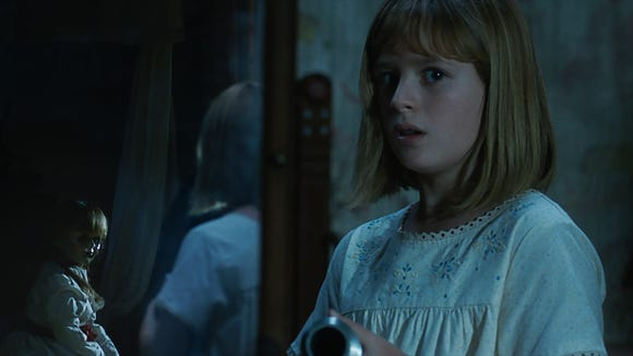 Annabelle keeps an eye on young Linda (Lulu Wilson) in 'Annabelle: Creation.'