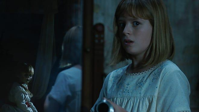 Annabelle keeps an eye on young Linda (Lulu Wilson) in 'Annabelle: Creation.'
