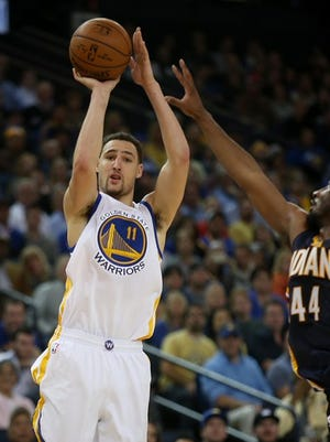 """Golden State Warriors' Klay Thompson (11) shoots over Indiana Pacers' Solomon Hill (44) in the fourth quarter of their NBA basketball game at Oracle Arena in Oakland, Calif., on Wednesday, Jan. 7, 2015. Thompson was the high scorer with 40 points as the Warriors won 117-102. (Jane Tyska/Bay Area News Group)"""
