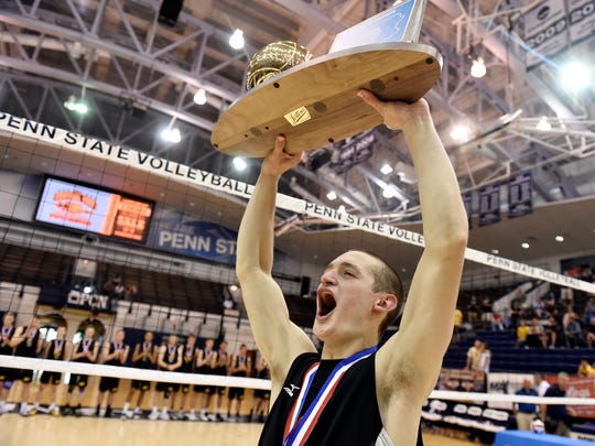 Central York's Carter Luckenbaugh hoists the PIAA Class 3A boys' volleyball championship trophy Saturday, June 10, 2017, at Penn State. Central York defeated North Allegheny 3-1 (20-25, 25-21, 25-22, 25-23) to win the Panthers' seventh boys' volleyball title.