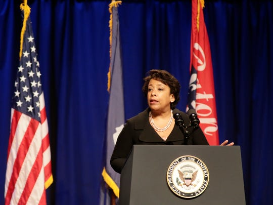 Attorney General Loretta Lynch addresses a memorial honoring three Baton Rouge law enforcement officers killed in a July 17 shootout, in Baton Rouge July 25.