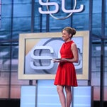 Jaymee Sire, who grew up on a Belt farm until she was five and graduated from Great Falls High, and Kevin Negandhi on the set of SportsCenter, in Bristol, Conn., in 2014.