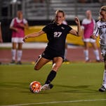 Senior midfielder Amanda Wilkin dribbles the ball up the field during a game last year against Miami. Wilkin is redshirting through her senior year due to a knee injury.