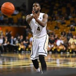 Senior Daiquan Walker had a season-high 21 points during the Knights' Dec. 5 game against UIC Flames.