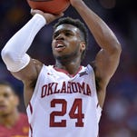 Mar 10, 2016; Kansas City, MO, USA;  Oklahoma Sooners guard Buddy Hield (24) shoots a free throw against the Iowa State Cyclones in the first half during the Big 12 Conference tournament at Sprint Center. Mandatory Credit: Denny Medley-USA TODAY Sports