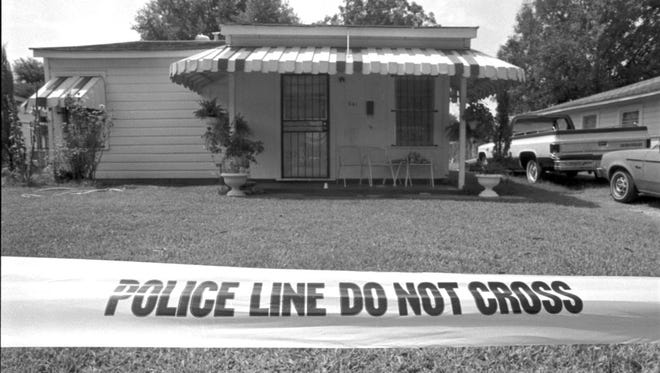 Police investigate the scene of the Aug. 5, 1987 killings of William T. Code, 73, Joe Robinson Jr., 12, and Eric Williams, 8, in Shreveport's Cedar Grove neighborhood. Code's grandson, Nathaniel R. Code Jr. later was arrested and charged with first-degree murder for the killings but was never tried.