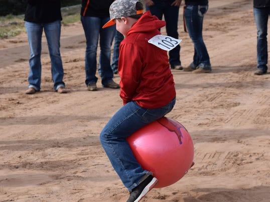 kid bouncing ball
