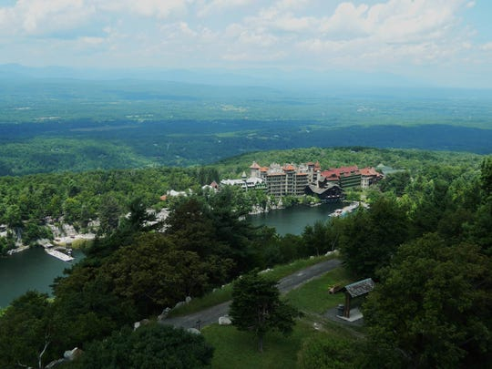 The Mohonk Mountain House in New Paltz sits snugly beside a lake.