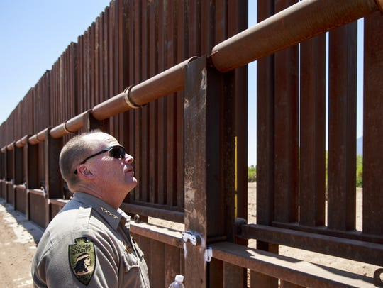 Cochise County Sheriff Mark Dannels looks through the