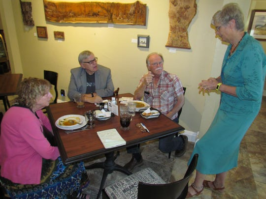 Left to right, Pastor Janine DeLaunay, Greg Johanson, Paul Toews and Kelly Schreiber during Canyon Conversations Sept. 14 at Moxieberry in downtown Stayton.