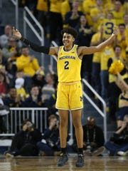 Michigan guard Jordan Poole reacts after a basket against Maryland during the second half Jan. 15, 2018 at the Crisler Center.