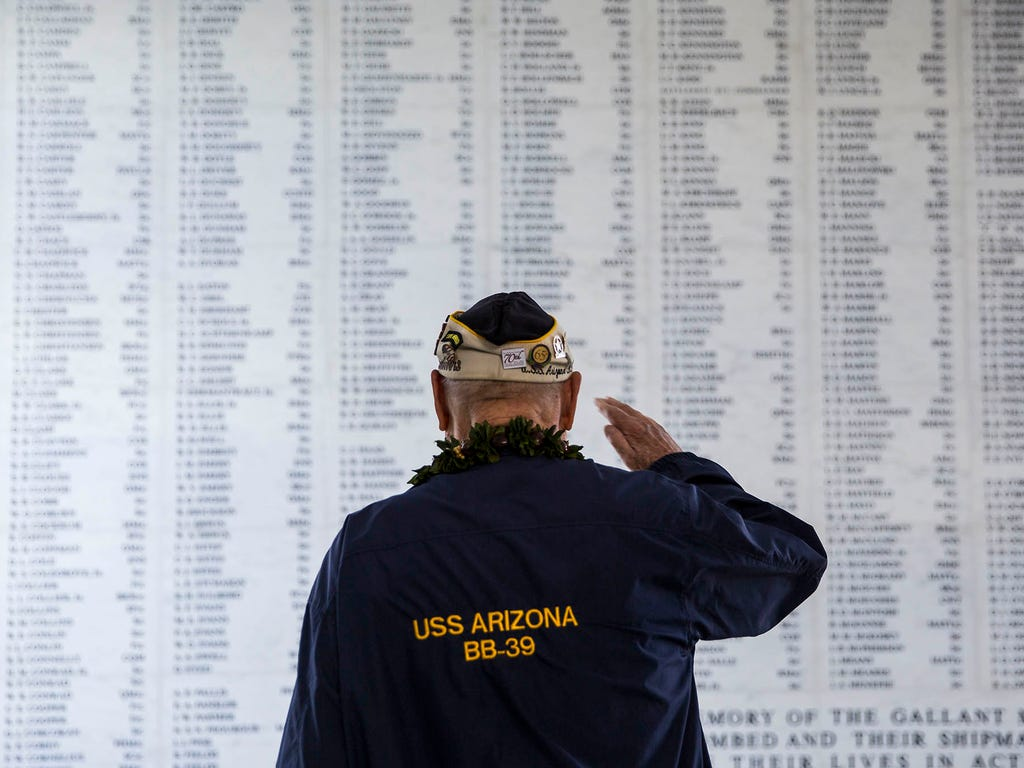 Louis Conter, a survivor from the battleship USS Arizona, salutes the remembrance wall during a memorial service on the 73rd anniversary of the Japanese attack on the U.S. naval base at Pearl Harbor  on Dec. 7 at Pearl Harbor, Hawaii.  A surprise mil