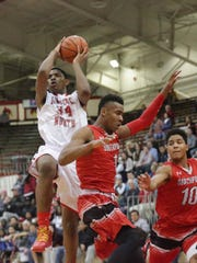 Kevin Easley Jr. shot over Southport's Paul Scrugs in their game Jan. 15.