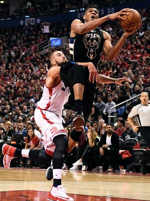 Bucks forward Giannis Antetokounmpo drives past Raptors center Jonas Valanciunas in the second half of Milwaukee's win over Toronto on Saturday at the Air Canada Centre.