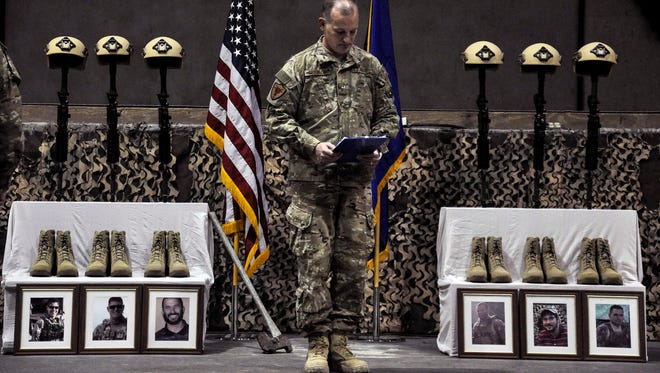 A U.S. Air Force officer speaks Wednesday, Dec. 23, 2015, during a memorial ceremony for six airmen killed in a suicide attack, at Bagram Air Field, Afghanistan. Among those killed was Joseph Lemm, a native of Iowa.